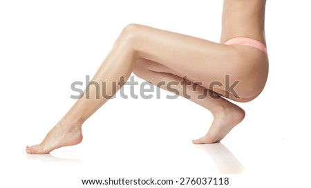 naked female legs and pink panties on a white background - stock photo
