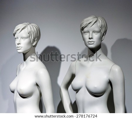 naked female puppet dummys in a window - stock photo