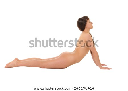 Naked girl is engaged in yoga isolated on a white background  - stock photo