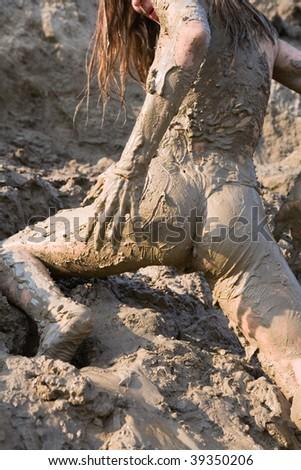 Naked girl soiled, rear view - stock photo