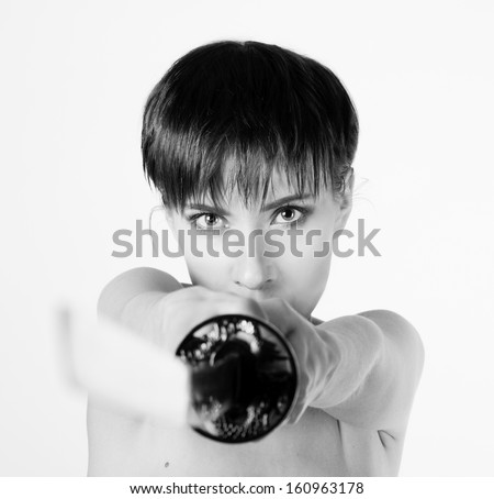 Naked girl with a katana - stock photo