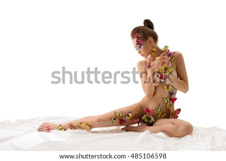 Naked girl with butterflies on her body