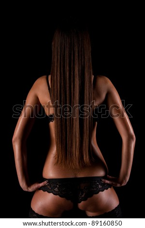 Naked Girl With Long Black Hair Sitting Backwards On A Chair In His