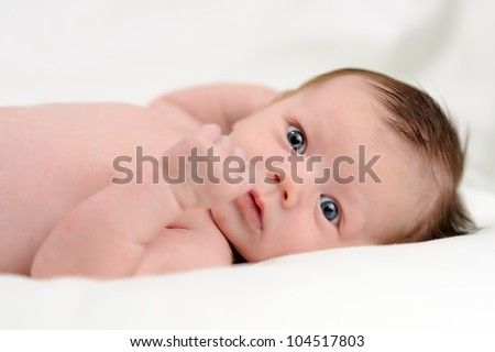 Naked Infant Lying on Back. One month old baby boy lying on his back while naked. Shallow DOF.