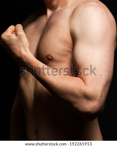 naked male chest and trained biceps