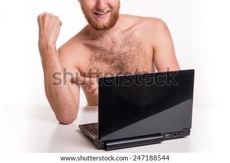 Naked man in front of webcam - studio shoot  - stock photo