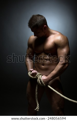 Naked man tied with rope. Concept of detention - stock photo