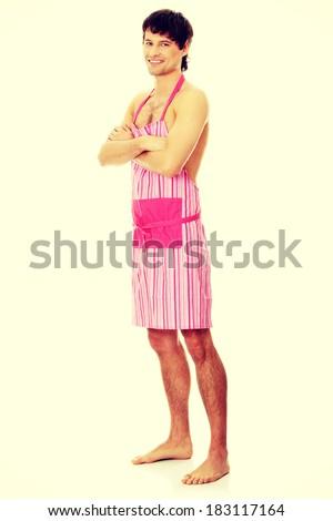 Naked man wering pink apron. Isolated on white. - stock photo
