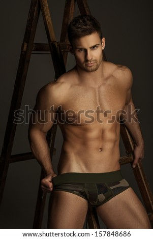 Handsome Hairy Chest Man Standing Hand On Body Stock Photo