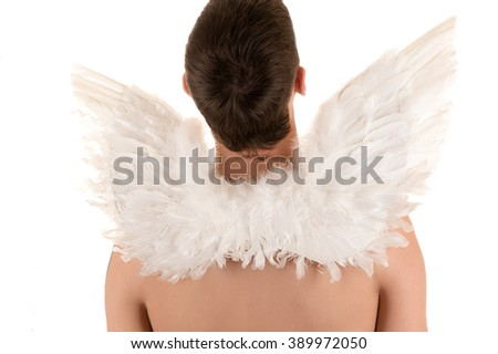 naked man with white angel wings on his back looking up