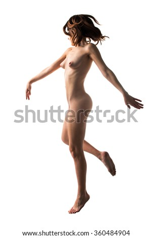 Naked pretty girl jumping - stock photo