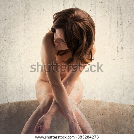 Naked pretty girl on vintage chair