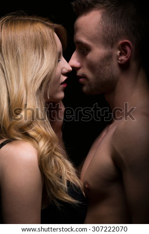 Naked romantic young couple caressing and kissing  - stock photo