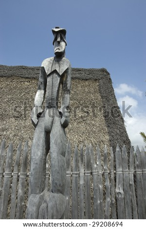 Naked Tiki idol with a sad face. Primitive polynesian carving. Place of Refuge in the Big Island. - stock photo