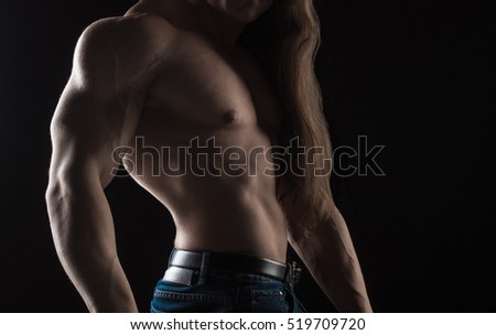 naked torso male bodybuilder athlete in the studio on a black background