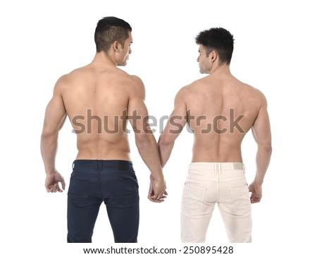 naked torso young gay couple holding hands showing muscular back and  strong gym built bodies in homosexual men love concept isolated on white background - stock photo
