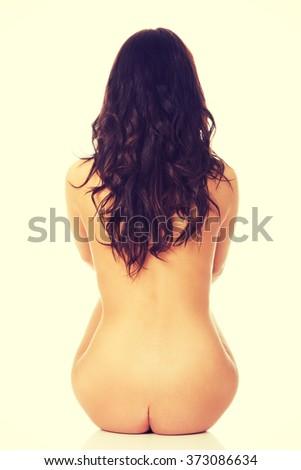 Naked woman back to camera. - stock photo