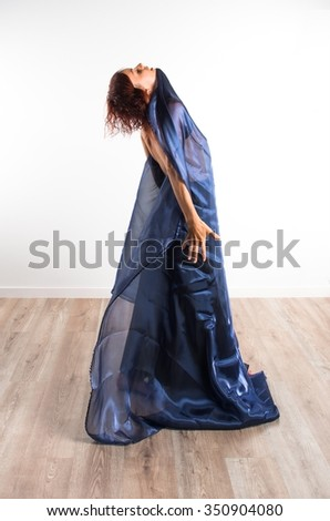 Naked woman dancing with big fabric