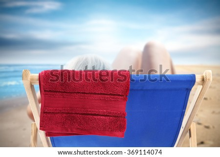 naked woman on chair and blue chair and free space
