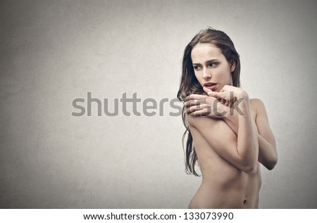 naked woman on gray background - stock photo