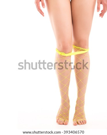 Naked woman's legs in yellow stockings down - stock photo