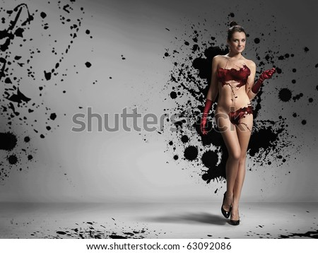 Naked woman wearing gloves - stock photo
