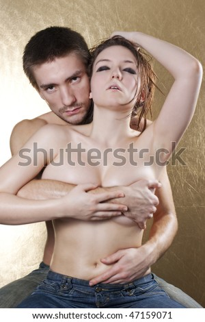 Naked young couple kissing and embracing - stock photo
