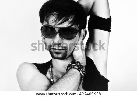 Naked young handsome man in sunglasses
