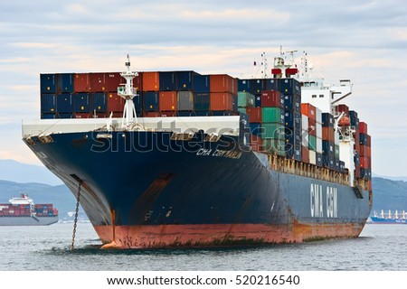 Nakhodka. Russia - August 2, 2015: Container ship CMA CGM Marlin standing on the roads at anchor.