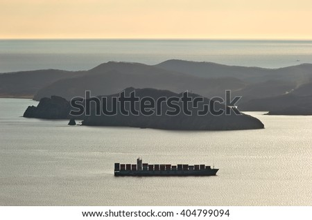 Nakhodka. Russia - March 24, 2016: Container ship companies COSCO anchored in the bay.
