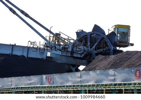 NAKHODKA, 2017: The place where the coal is being loaded into bulk cargo ship by big cargo cranes. Nakhodka bay, town of Nakhodka, the Far East of Russia. Aerial.