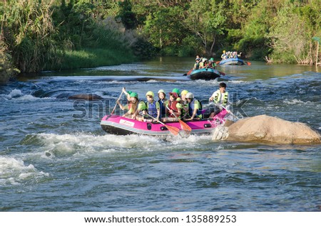NAKHON NAYOK,THAILAND-DECEMBER 29 : Unidentified people in action at rafting adventure 2011 on Kang Tiam  river in Khao Yai National park on December 29,2011 in Nakhon Nayok,Thailand .