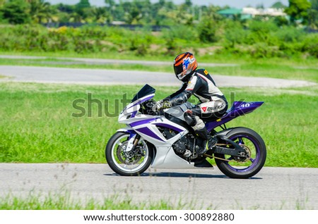 NAKHON PATHOM - JULY 25 : Anusorn n. with suzuki K750 motorcycle in Thailand SuperBikes Championship 2015 Round 1 at Thailand Circuit, on July 25, 2015 in Nakhon Pathom, Thailand. - stock photo
