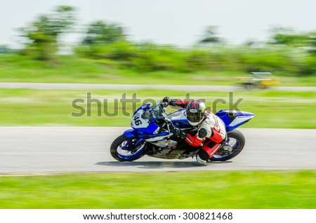 NAKHON PATHOM - JULY 25 : Kemin Kubo with Yamaha R3 motorcycle in Thailand SuperBikes Championship 2015 Round 1 at Thailand Circuit, on July 25, 2015 in Nakhon Pathom, Thailand. - stock photo