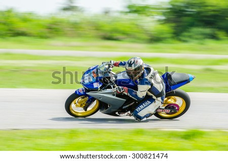 NAKHON PATHOM - JULY 25 : Pongsiri O. with Yamaha R3 motorcycle in Thailand SuperBikes Championship 2015 Round 1 at Thailand Circuit, on July 25, 2015 in Nakhon Pathom, Thailand. - stock photo