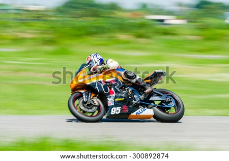 NAKHON PATHOM - JULY 25 : Thanapon S. with Suzuki GSXR1000  motorcycle in Thailand SuperBikes Championship 2015 Round 1 at Thailand Circuit, on July 25, 2015 in Nakhon Pathom, Thailand. - stock photo