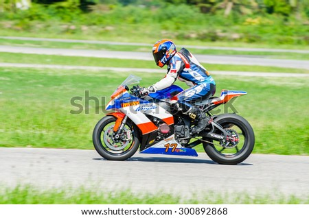 NAKHON PATHOM - JULY 25 : Thaworn P. with Kawasaki Ninja motorcycle in Thailand SuperBikes Championship 2015 Round 1 at Thailand Circuit, on July 25, 2015 in Nakhon Pathom, Thailand. - stock photo