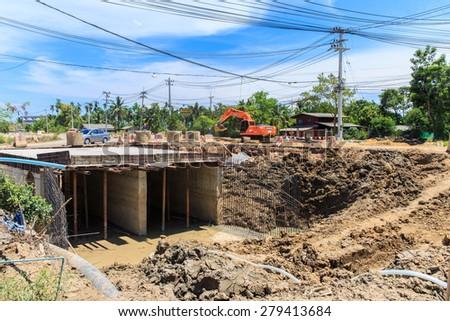 NAKHON PATHOM-THAILAND-MAY 16 : A loader for construction the road on May 16, 2015 Bangkok, Thailand. - stock photo