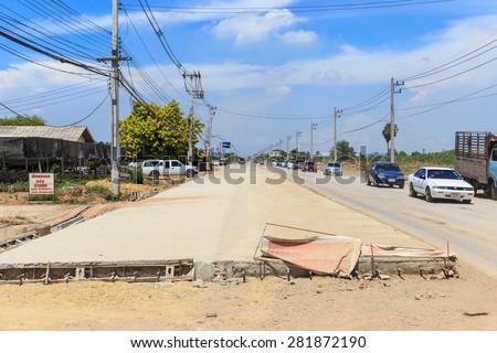 NAKHON PATHOM-THAILAND-MAY 16 : Construction of concrete road nakhonchaisri salaya on May 16, 2015 Nakhon Pratom, Thailand. - stock photo