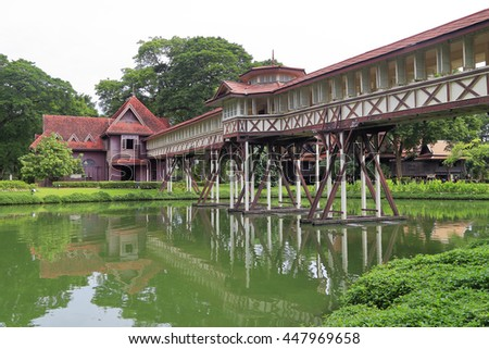 NAKHON PHATHOM//THAILAND - JULY 3: Wooden Pathway connection and its reflection over pond in Sanam Chandra Palace built by King Vajiravudh (Rama IV), July 3, 2016  in Nakhon Pathom, Thailand