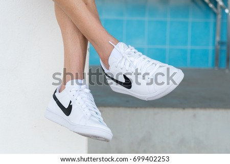 NAKHON PRATHOM, THAILAND - AUGUST 12, 2017:The woman wearing Nike tennis shoes classic Nike, Inc. is an American multinational corporation that designs, develops, manufactures and sells tennis shoes.