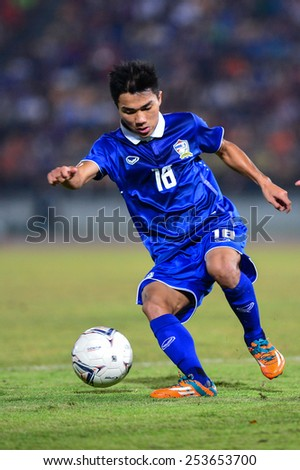 NAKHON RATCHASIMA THA-Feb07:Chanathip Songkrasin of Thailand contols a ball during the 43rd King's cup match between Thailand and Korea Rep at Nakhon Ratchasima stadium on February07,2015 in Thailand. - stock photo