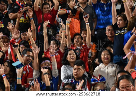 NAKHON RATCHASIMA THA-Feb07:Cheers on his team during of Thailand in action during the 43rd King's cup match between Thailand and Korea Rep at Nakhon Ratchasima stadium on February07,2015 in Thailand - stock photo