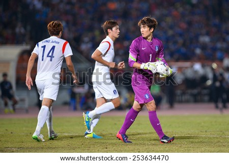 NAKHON RATCHASIMA THA-Feb07:Goalkeeper Kim Seung-gyu of Korea for the ball during the 43rd King's cup match between Thailand and Korea Rep at Nakhon Ratchasima stadium on February07,2015 in Thailand. - stock photo