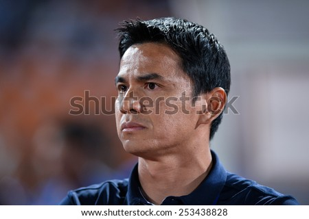 NAKHON RATCHASIMA THA-Feb07:Head Coach Kiatisuk Senamuang of Thailand   during the 43rd King's cup match between Thailand and Korea Rep at Nakhon Ratchasima stadium on February07,2015 in Thailand. - stock photo