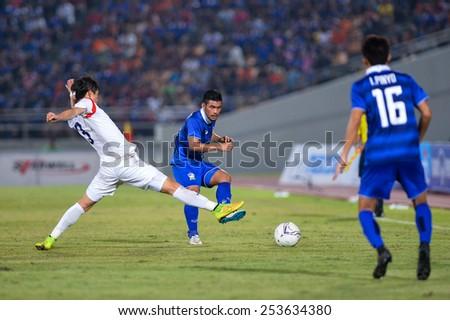 NAKHON RATCHASIMA THA-Feb7:Kroekrit Thaweekarn(B)of Thailand kicks the ball during the 43rd King's cup match between Thailand and Korea Rep at Nakhon Ratchasima stadium on February07,2015 in Thailand. - stock photo