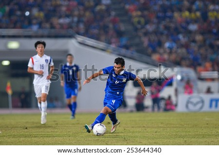 NAKHON RATCHASIMA THA-Feb07:Kroekrit Thaweekarn#4 of Thailand contols a ball during the 43rd King's cup match between Thailand and Korea Rep at Nakhon Ratchasima stadium on February07,2015 in Thailand - stock photo