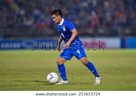 NAKHON RATCHASIMA THA-Feb07:Kroekrit Thaweekarn of Thailand contols a ball during the 43rd King's cup match between Thailand and Korea Rep at Nakhon Ratchasima stadium on February07,2015 in Thailand. - stock photo