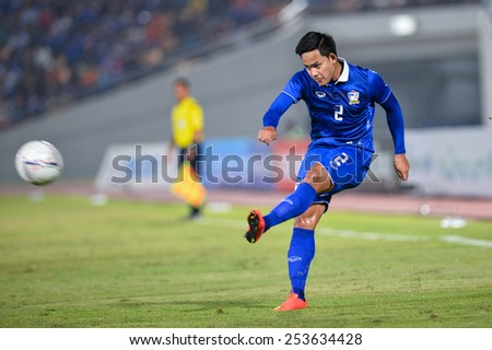 NAKHON RATCHASIMA THA-Feb07:Peerapat Notchaiya of Thailand hit the ball during the 43rd King's cup match between Thailand and Korea Rep at Nakhon Ratchasima stadium on February07,2015 in Thailand. - stock photo