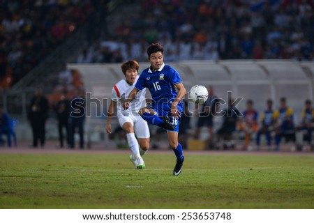 NAKHON RATCHASIMA THA-Feb07:Pinyo Inpinit#16 of Thailand hit the ball during the 43rd King's cup match between Thailand and Korea Rep at Nakhon Ratchasima stadium on February07,2015 in Thailand. - stock photo
